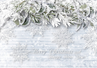 Wooden background with Christmas border and delicate snowflakes