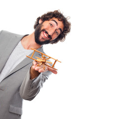 young crazy man with a wooden plane