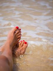 closeup of woman feet on the beach