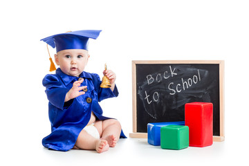 funny kid with bell in academician clothes at chalkboard