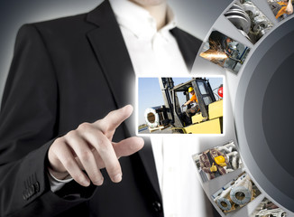 Businessman hand pressing touch screen with pictures of workers