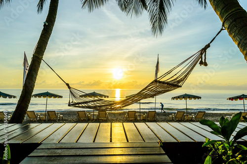 canvas print picture Hammock of the palm on the tropical beach