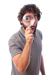 young crazy man with a magnifier
