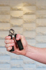 Man with hand grip exerciser