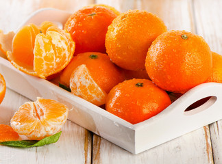 Fresh Tangerines  on  a wooden background