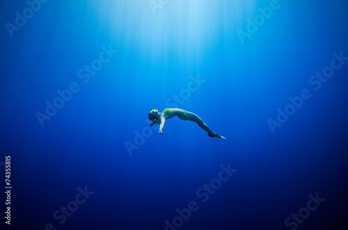 girl swimming underwater - 74355815