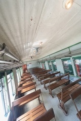Interior of an empty antiqued train cabin