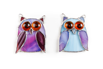 Colorful stained glass hand-made owls isolated on white