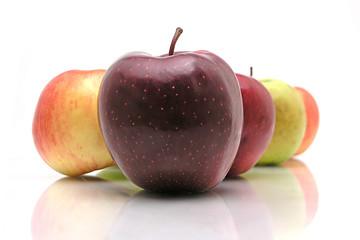 Several apples on white glass