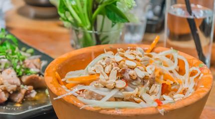 Thai style papaya salad in bowl