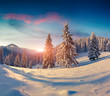 Beautiful winter sunrise in the snowy mountains