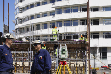 surveying instrument, workers and construction industry