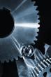 cogwheels and gears against black velvet background