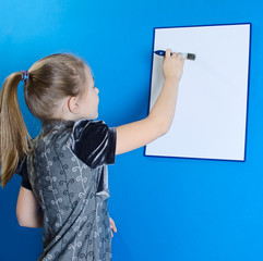 the girl shows a white plastic board