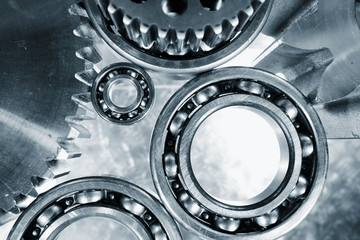 ball-bearings, gears and cogwheels in blue toning idea