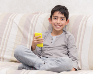 smiling young boy with smart phone