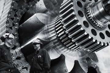 engineers, workers with large cogwheels machinery