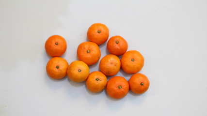 Oranges in wooden tray.