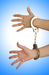 Handcuffed hands on white background