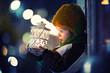 Leinwanddruck Bild - Cute boy, holding lantern outdoor