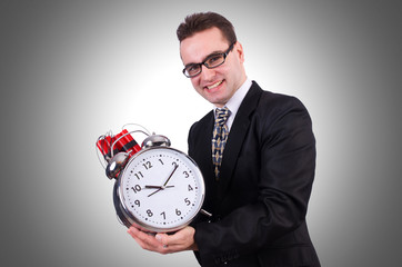 Man with time bomb isolated on white