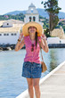 Young woman in hat enjoying vacation time