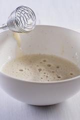 whisking egg with sugar and vanilla