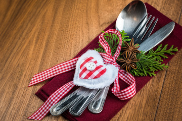 Christmas table setting on wooden table with copy text space