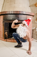 Fitness Santa Claus out of the chimney