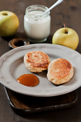 Curd pancakes with apple jam. Breakfast with yogurt