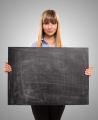 Woman holding a blackboard