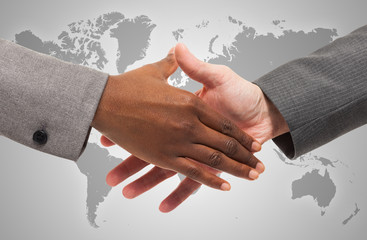 Handshake between business people of different ethnicity