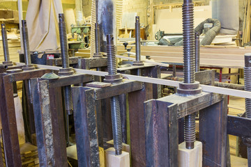 clamps holding workpiece gluing