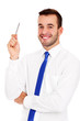 Successful businessman posing with a pen