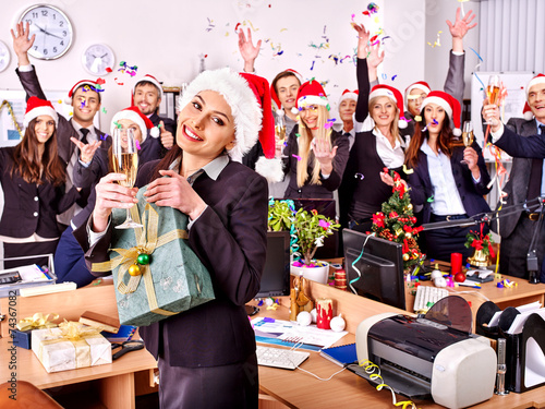 Business group people in santa hat at Xmas party. - 74367082