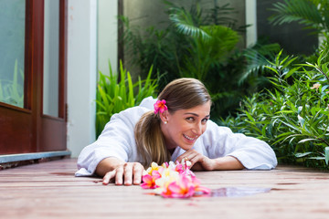 Woman with flowers at tropical pool