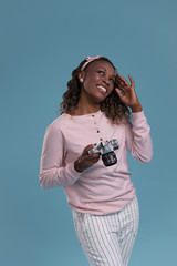 Young african woman photographing