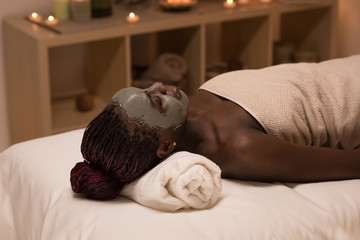 African woman relaxing in spa salon