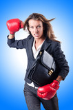 Angry businesswoman with boxing gloves