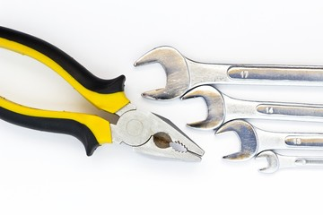 Metal wrenches and pliers isolated on white background