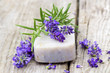 bar of natural soap, lavender flowers and rosemary