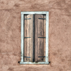 wooden shutters in a rustic wall