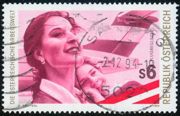 stamp printed by Austria, shows Stewardess, child