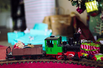 Model train with Xmas tree and gifts