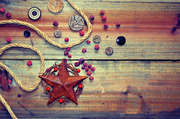 Decorative star element with buttons on a wooden background