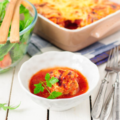 Pork Meatballs baked with Tomato Sauce and Cheese
