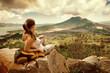Woman traveler looking at Batur volcano