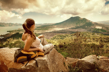 Woman traveler looking at Batur volcano