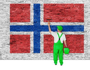 house painter covers wall with flag of Norway