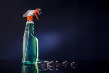Spray bottle on a dark background